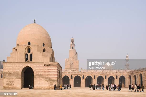 Visitors gather in the courtyard of the ninthcentury mosque of Ibn Tulun in the Egyptian capital Cairo on January 11 with its landmark dome and the...