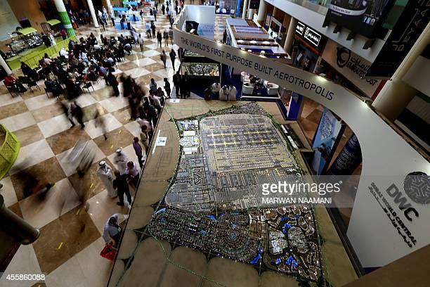 Visitors gather near a scale model of Sheikh Maktoum International airport at the annual Cityscape Global show which has served in the past as the...