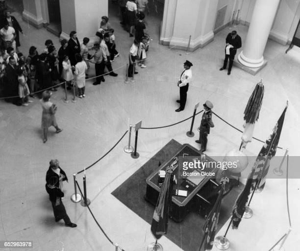 Visitors gather outside ropes to view the desk used by the late President Kennedy at the traveling John F Kennedy Library Exhibit at the Museum of...