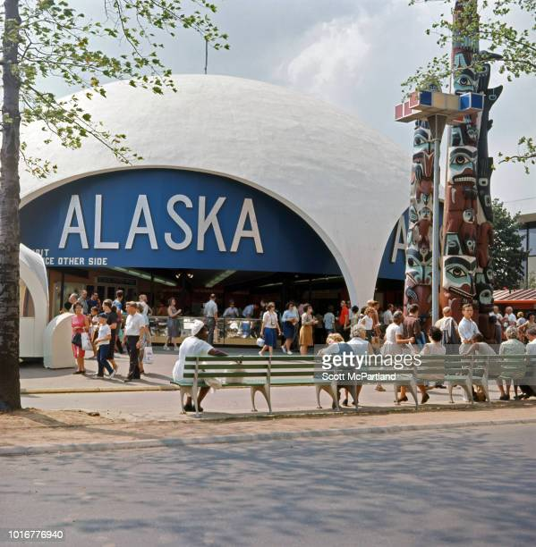 Tourists gather outside the Alaska Pavilion during the World's Fair in Flushing Meadows Park Queens New York New York June 1965