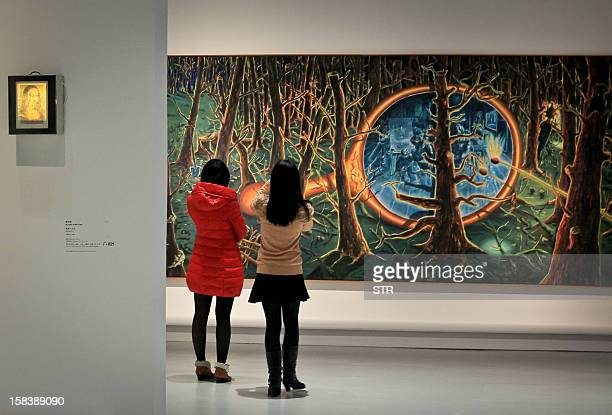 Visitors gather to admire the latest exhibits by Centre Pompidou a leading French museum of modern and contemporary art at the Shanghai China Art...