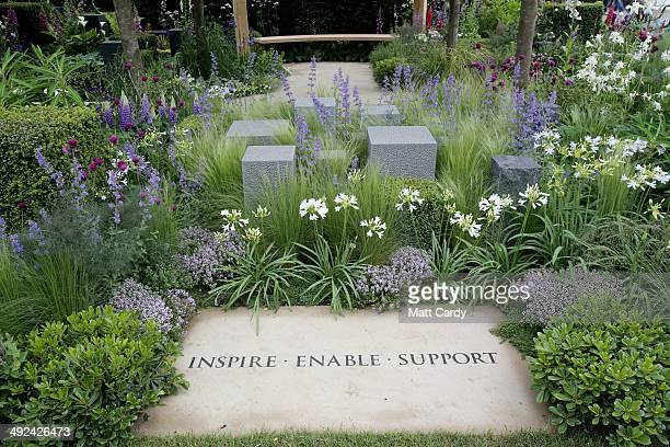 Visitors gather to admire the the Help For Heroes award winning garden at the RHS Chelsea Flower Show in the grounds of the Royal Hospital Chelsea on...