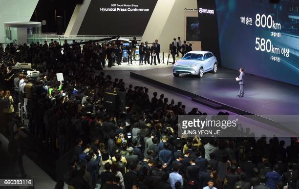 Visitors gather to look Hyundai Motor's FE Fuel Cell Concept during a press preview of the Seoul Motor Show in Goyang northwest of Seoul on March 30...