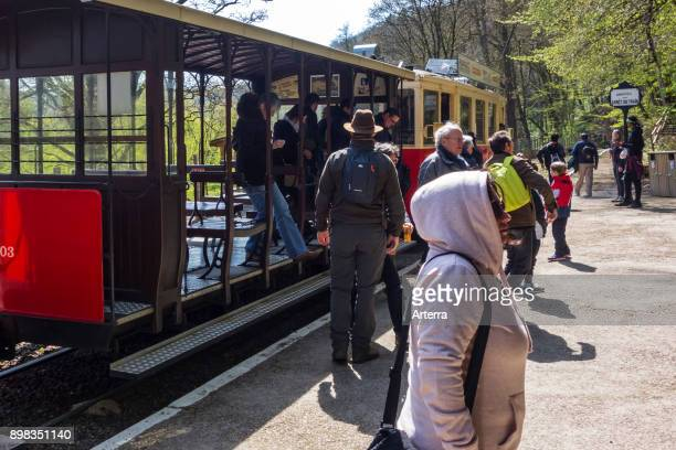 Visitors getting off train to the Caves of HansurLesse / Grottes de Han Belgian Ardennes Belgium