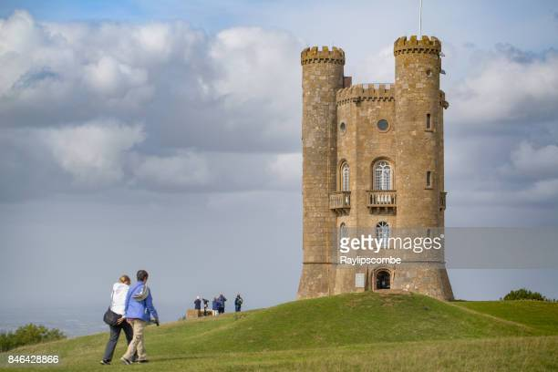 Visitors giving some scale against the historic Broadway Tower