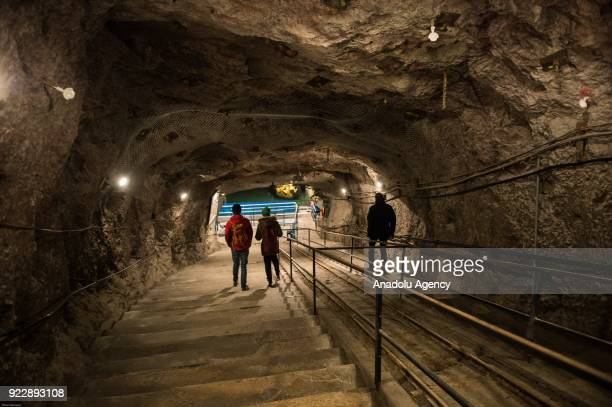 Visitors go down stairs at the 445 meters long tunnel in Seegrotte Vienna Austria on February 22 2018 Seegrotte the largest European underground lake...