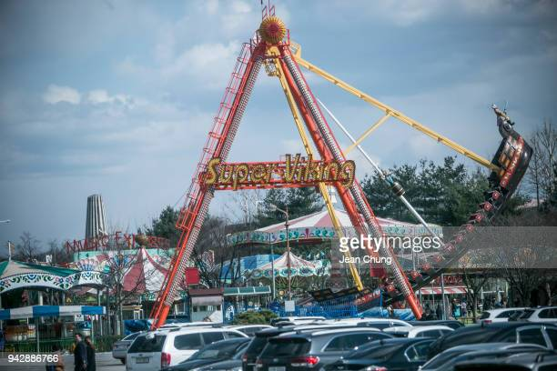 Visitors go on a ride amusement park near the fortified Demilitarised Zone on April 7 2018 in Paju South Korea On April 27 South Korean President...