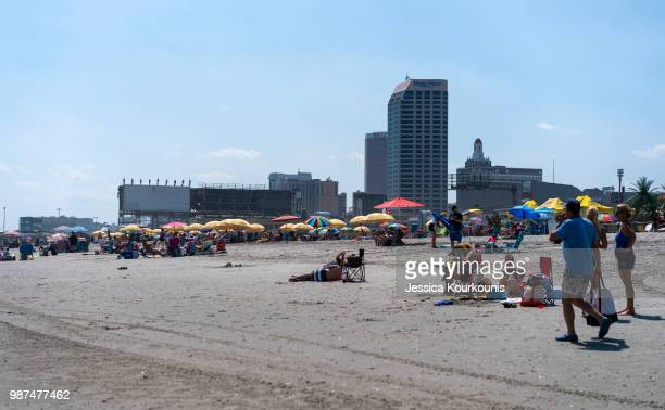 Visitors hang out on the beach on June 29 2018 in Atlantic City New Jersey Two new casinos opened this week in the seaside resort as residents seek...