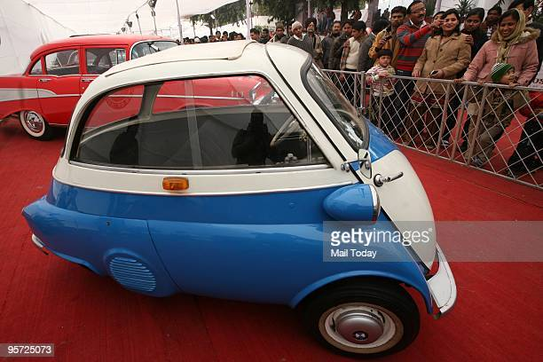 Visitors have a look at a 1955 BMW Isetta 300 vintage car displayed at the ongoing Auto Expo 2010 at Pragati Maidan in New Delhi on Sunday January 10...