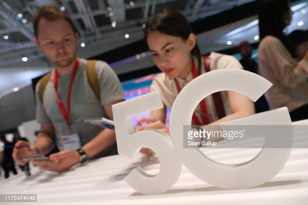 Visitors have a look at new Samsung 5G compatible devices at the 2019 IFA home electronics and appliances trade fair on September 05 2019 in Berlin...