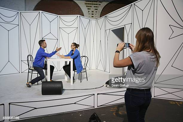 """Visitors have fun in an installation piece by Julian Goethe at the """"art berlin contemporary"""" art trade fair at The Station on September 20, 2014 in..."""