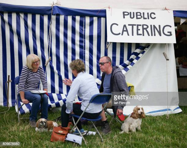Visitors have some food during the Osmotherley Country Show on August 5, 2017 in Osmotherley, England. The annual show hosts pony, cattle and sheep...