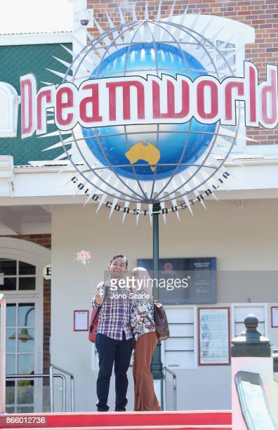 Visitors have their photo taken at Dreamworld on October 25 2017 in Gold Coast Australia Four people were killed following an accident on the Thunder...