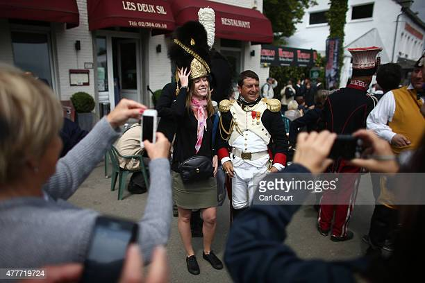 Visitors have their photographs taken with historical reenactors in period costume on June 19 2015 in Waterloo Belgium Around 5000 historical...