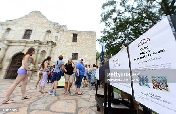 Visitors head for the ticket counter to enter the Alamo on June 14 2013 in San Antonio Texas The Alamo built as a chapel after 1744 is all that...