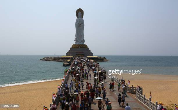 Visitors head to Sanya Nanshan Buddhism Cultural Tourism Zone to visit threesided statue of Guan Yin Buddha on March 16 2017 in Sanya Hainan Province...