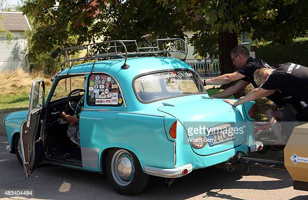 Visitors help push start a Trabant automobile at a Trabant enthusiasts' weekend on August 8 2015 near Nossen Germany The Trabant also called the...