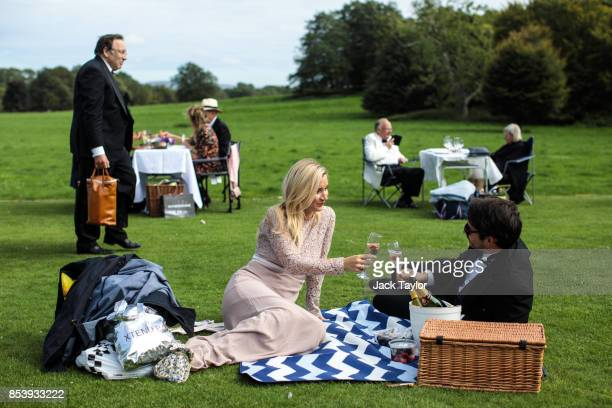 Visitors hold picnics in the grounds of Glyndebourne opera house before a production of La Traviata on August 04, 2017 in Lewes, England. The Season...