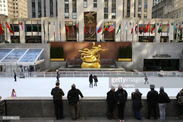 Visitors ice skate at the ice rink of Rockefeller Center in New York United States on February 2 2017 Rockefeller Center opened in 1939 has an...