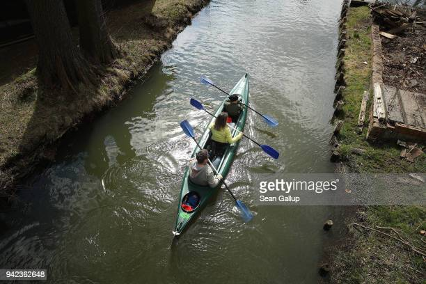 Visitors in a canoe paddle on a canal in the Spreewald region on April 5, 2018 in Luebbenau, Germany. The Spreewald is a thickly-forested region...