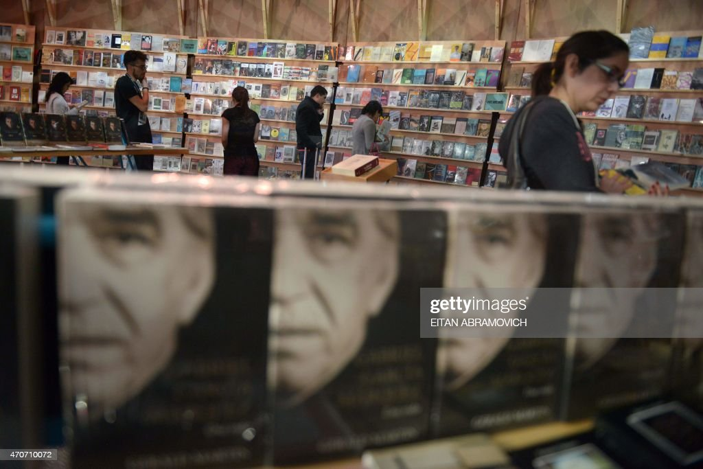Visitors in a pavilion dedicated to Macondo, the fictitious town in which many of late Colombian Nobel laurate Gabriel Garcia Marquez's stories were set, during the International Book Fair of Bogota, on April 22, 2015, in Bogota, Colombia. The 2015 Bogota International Book Fair dedicates a tribute to Garcia Marquez, a year from his death. AFP PHOTO/Eitan Abramovich /