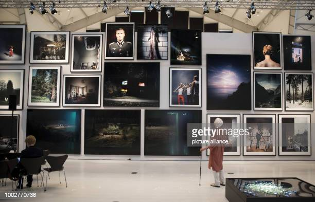 Visitors in a room with works by German photographer Andreas Muehe before a press conference at the Deichtorhallen in Hamburg Germany 18 May 2017 The...