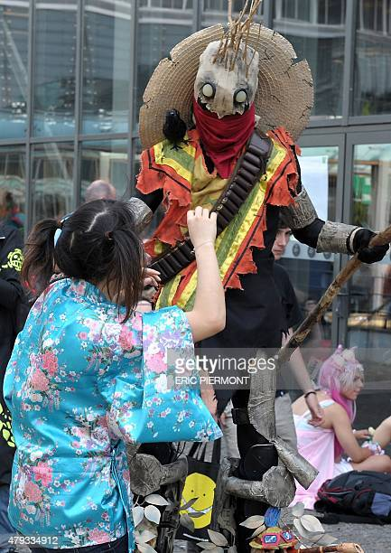 Visitors in anime/manga and game cosplay are pictured at the Japan Expo 2015 exhibition devoted to Japanese culture and entertainment on July 3 2015...
