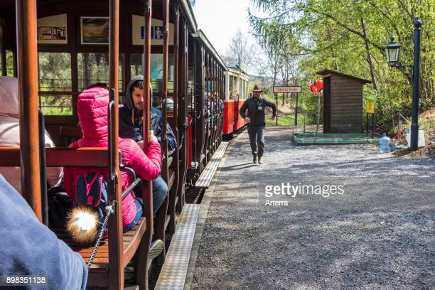 Visitors in open carriages of the train to the Caves of HansurLesse / Grottes de Han Belgian Ardennes Belgium