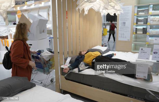 Visitors in protective masks examine mattresses in IKEA mall, on September 27, 2020 in Moscow, Russia. The requirement to wear masks and gloves to...