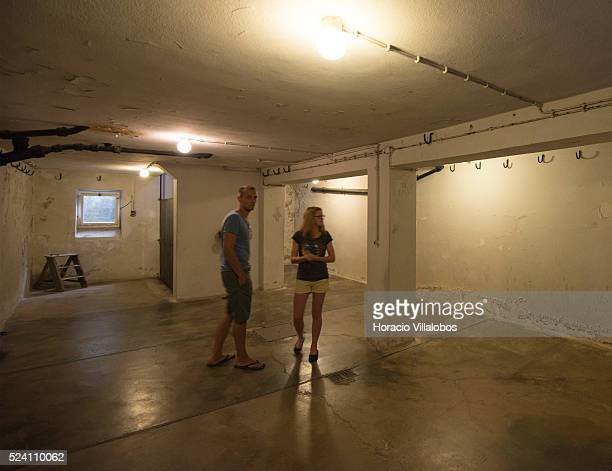 Visitors in the 'Strangling Room' called by the Nazis 'Leichenkeller' at the basement of the crematorium in Buchenwald concentration camp near Weimar...