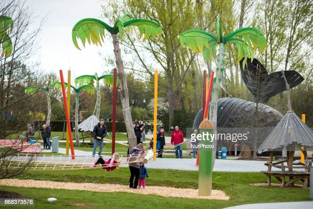 Visitors in the water play area are pictured during the opening of the IGA 2017 in Berlin Germany on April 13 2017 The exhibition will open from...