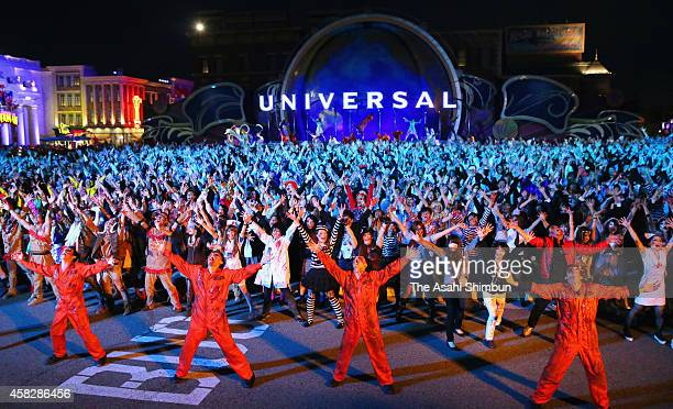 Visitors in zombie costumes stage an impromptu dance at Universal Studios Japan on October 31 2014 in Osaka Japan