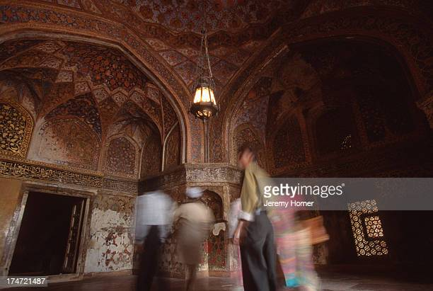 Visitors inside a palace at the ancient city of Fatehpur Sikri Uttar Pradesh A World Heritage Site Fatehpur Sikri is a 16th century capital city...