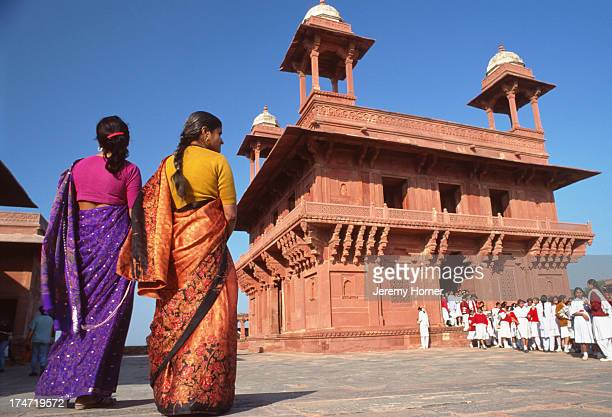 Visitors inside the ancient city of Fatehpur Sikri Uttar Pradesh A World Heritage Site Fatehpur Sikri is a 16th century capital city built by Mughal...