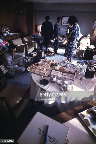 Visitors inside the Beatles hotel suite at the Tokyo Hilton during the band's tour of Asia 1966 Paul McCartney has his back to the camera