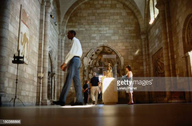 Visitors inside The Cloisters, a museum in the grounds of the Fort Tryon Park, housing the Metropolitan Museum of Art's collection of medieval art.