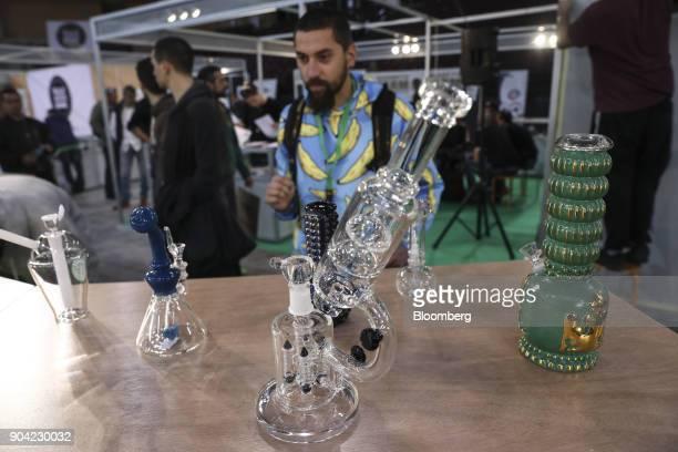 Visitors inspect a display of marijuana smoking apparatus also known as 'bongs' at the 1st International Cannabis Expo at the Faliro Sports Pavilion...