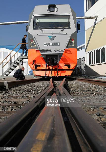 Visitors inspect a 'Granite' 2ES10 freight locomotive manufactured by Ural Locomotives a joint venture between Siemens AG and Sinara Group at the III...
