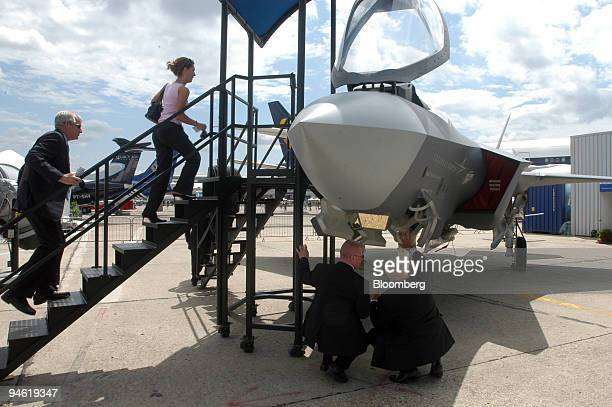 Visitors inspect a jet at the Lockheed Martin stand at the 47th International Paris Air Show in Le Bourget France on Wednesday June 20 2007