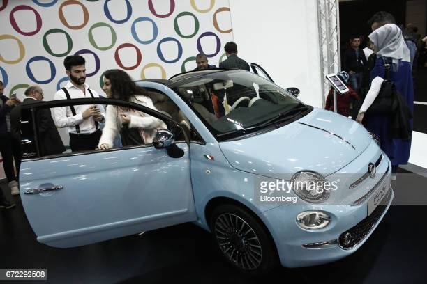Visitors inspect a roofless Fiat 500 Riva automobile manufactured in Turkey by Fiat Chrysler Automobiles NV at the Istanbul Autoshow in Buyukcekmece...