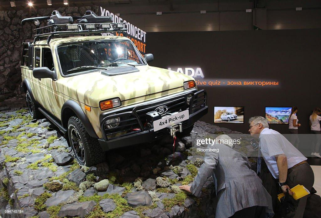 Visitors inspect a vintage Lada 4x4 pick-up automobile on