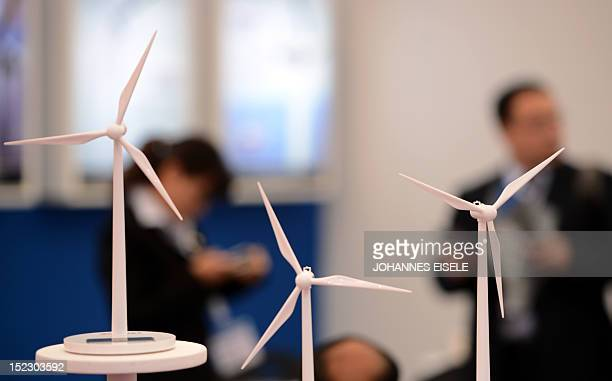 Visitors inspect exhibits at the at the HUSUM WindEnergy 2012 fair on September 18 2012 in Husum northern Germany The international trade fair for...