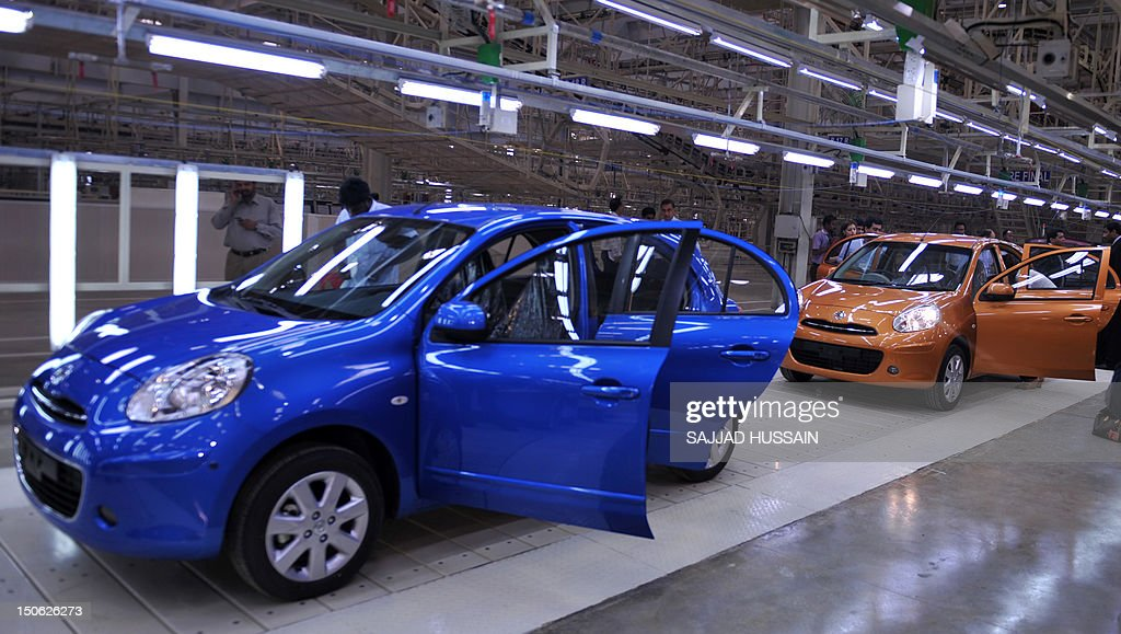 Visitors inspect Nissan Micra cars at the newly-inaugurated Renault ...