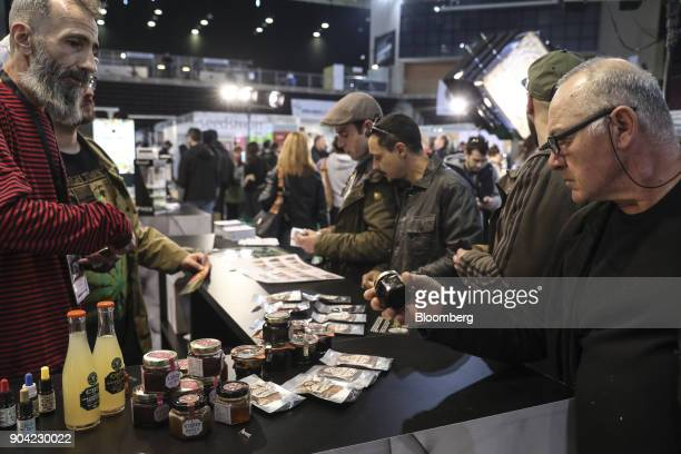 Visitors inspect products containing cannabis at the 1st International Cannabis Expo at the Faliro Sports Pavilion in Athens Greece on Friday Jan 12...