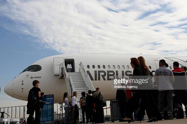Visitors inspect the Airbus MSN5 the fifth and final member of the A350 XWB flight test fleet during the 10th Istanbul Airshow 2014 in Istanbul...