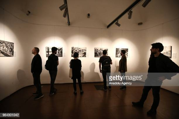 Visitors inspect the awardwinning photographs of Anadolu Agencys Istanbul Photo Awards 2018 during the exhibition at the Maksem Cumhuriyet Art...