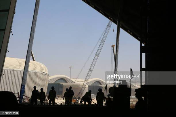 Visitors inspect the construction site of Abu Dhabi airport's MidField terminal complex in Abu Dhabi United Arab Emirates on Monday Nov 6 2017 The...