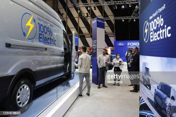 Visitors inspect the Ford Motor Co. E-Transit electric van during the Commercial Vehicle Show 2021 in Birmingham, U.K., on Tuesday, Aug. 31, 2021....