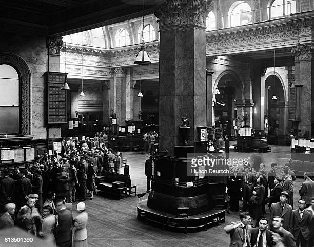 Visitors inspect the main hall of the Stock Exchange, during an open day tour.