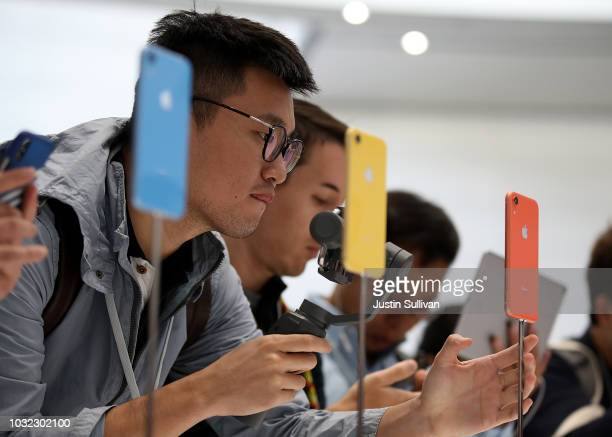 Visitors inspect the new iPhone XR during an Apple special event at the Steve Jobs Theatre on September 12 2018 in Cupertino California Apple...